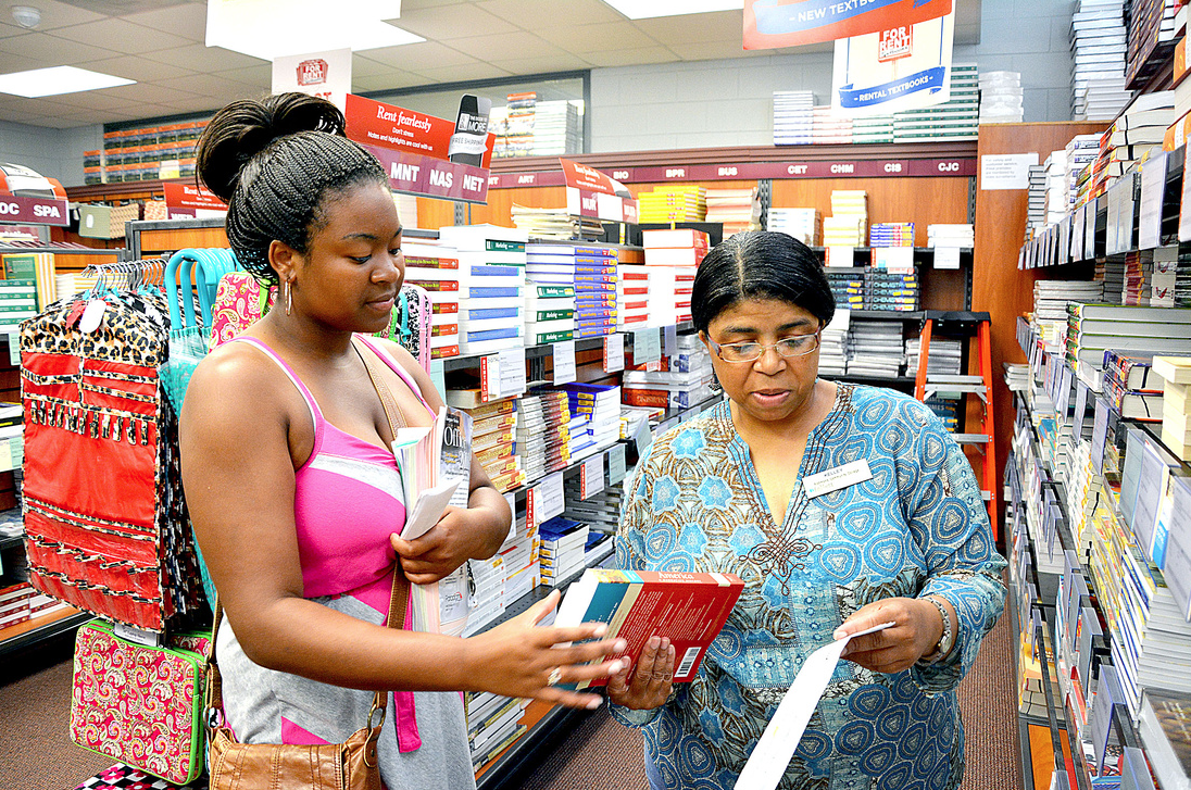 Student talks to an RCC Bookstore associate about purchasing books for her class.