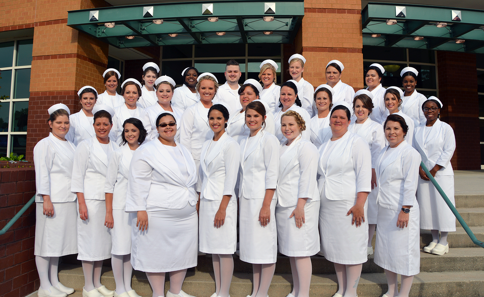 Class of 2017 Associate Degree of Nursing students on the steps of the Cole Auditorium