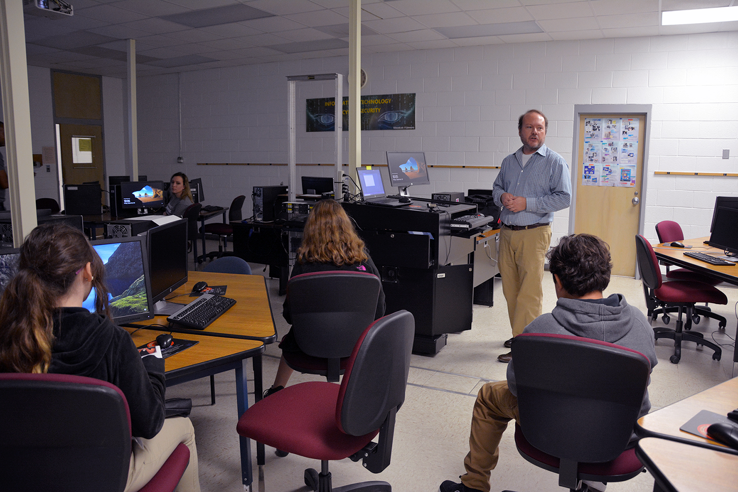 IT instructor talking to students in classroom