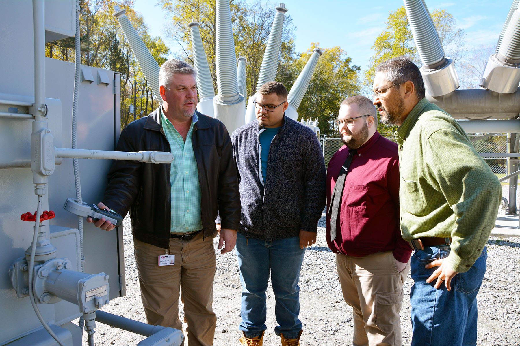 EUSRT students and instructors stand in the substation using ground resistance tester