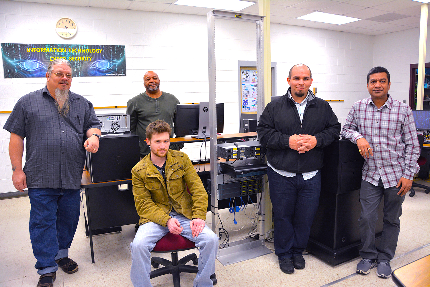Pictured are the Richmond Community College Information Technology students who completed IT projects for FerroFab in Hamlet. From left to right are Edward Hartley, Taylor Smith (seated), Lindell Bright, Kevin Taylor and Himansu Patel