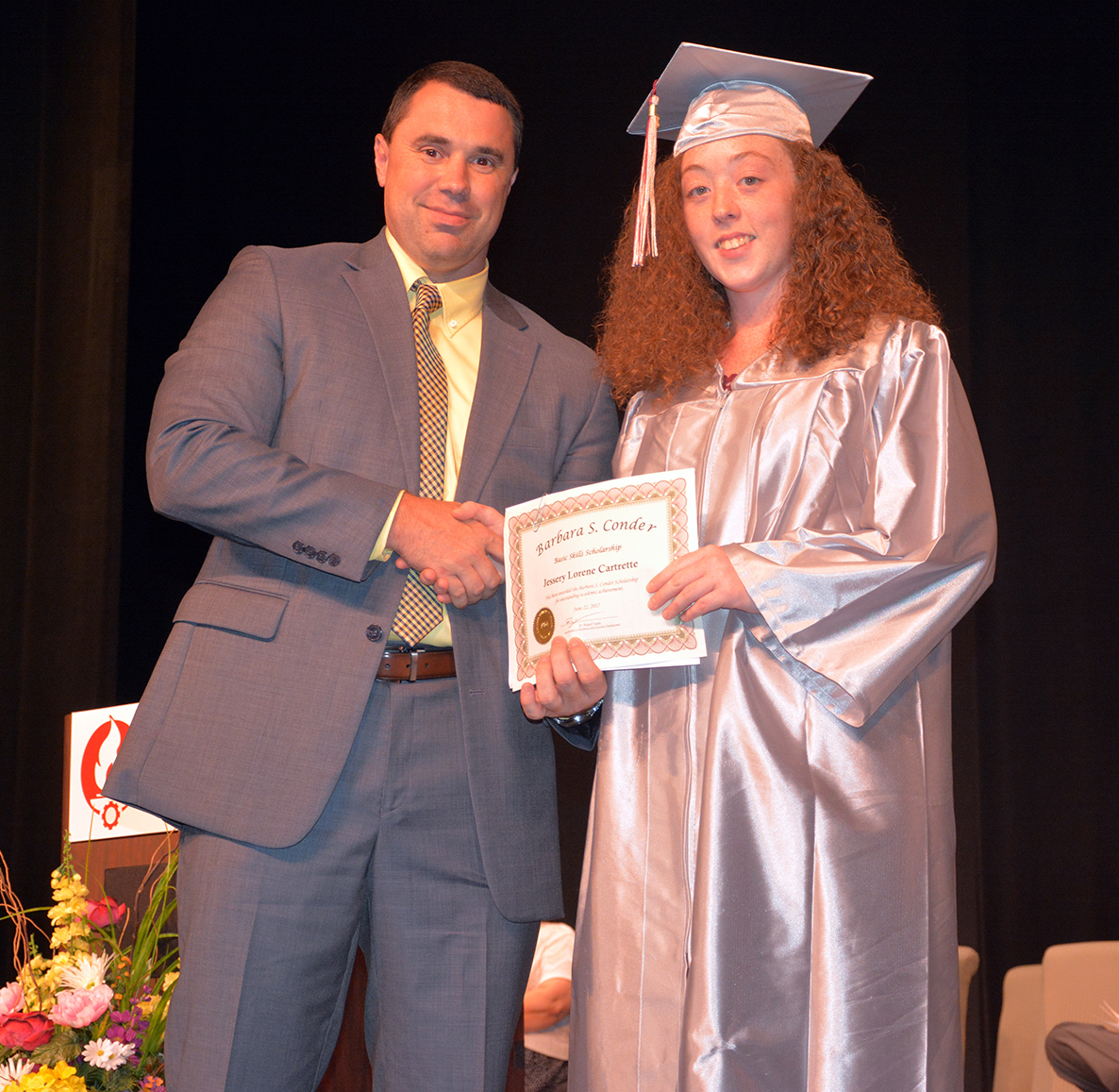 1 Jessery Cartrelle.jpg:  Pictured is Adult High School graduate Jessery Cartrelle receiving the Barbara S. Conder Basic Skills Scholarship. Presenting the scholarship is Dr. Robbie Taylor, vice president of the Workforce and Economic Development division at Richmond Community College