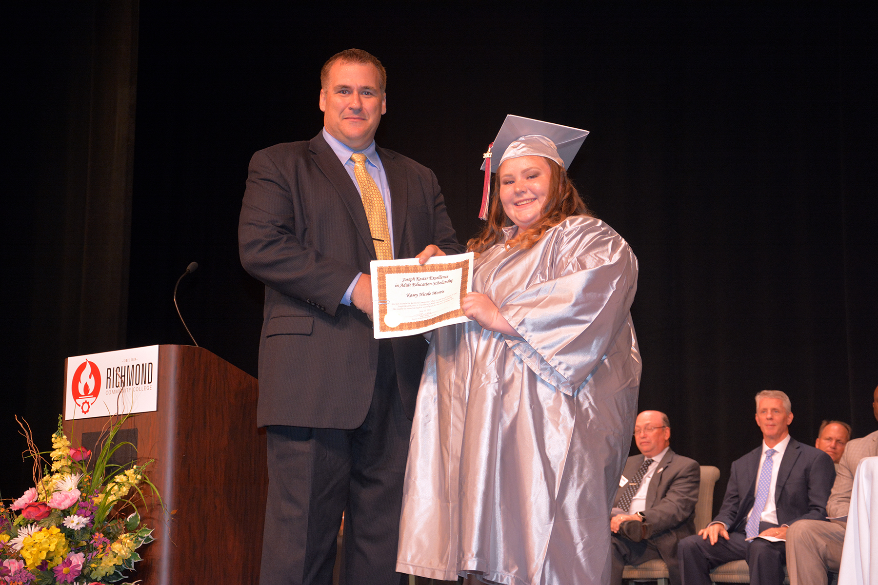 Pictured is Adult High School graduate Kasey Morris receiving the Joseph R. Kester Excellence in Education Scholarship from Richmond Community College Director of Adult Education John Kester.