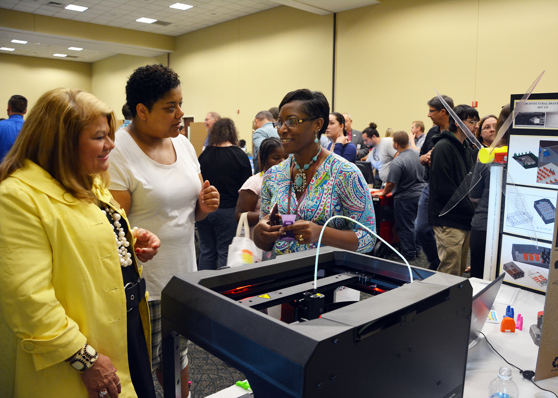 Mechanical Engineering lead instructor Annie Smith, right, explains how her students design parts and then print them on a 3D printer, which she had on display during last year's RichmondCC Open House. This year's Open House is scheduled for Thursday, April 27, from 5:30 to 7:30 p.m. at the Cole Auditorium.