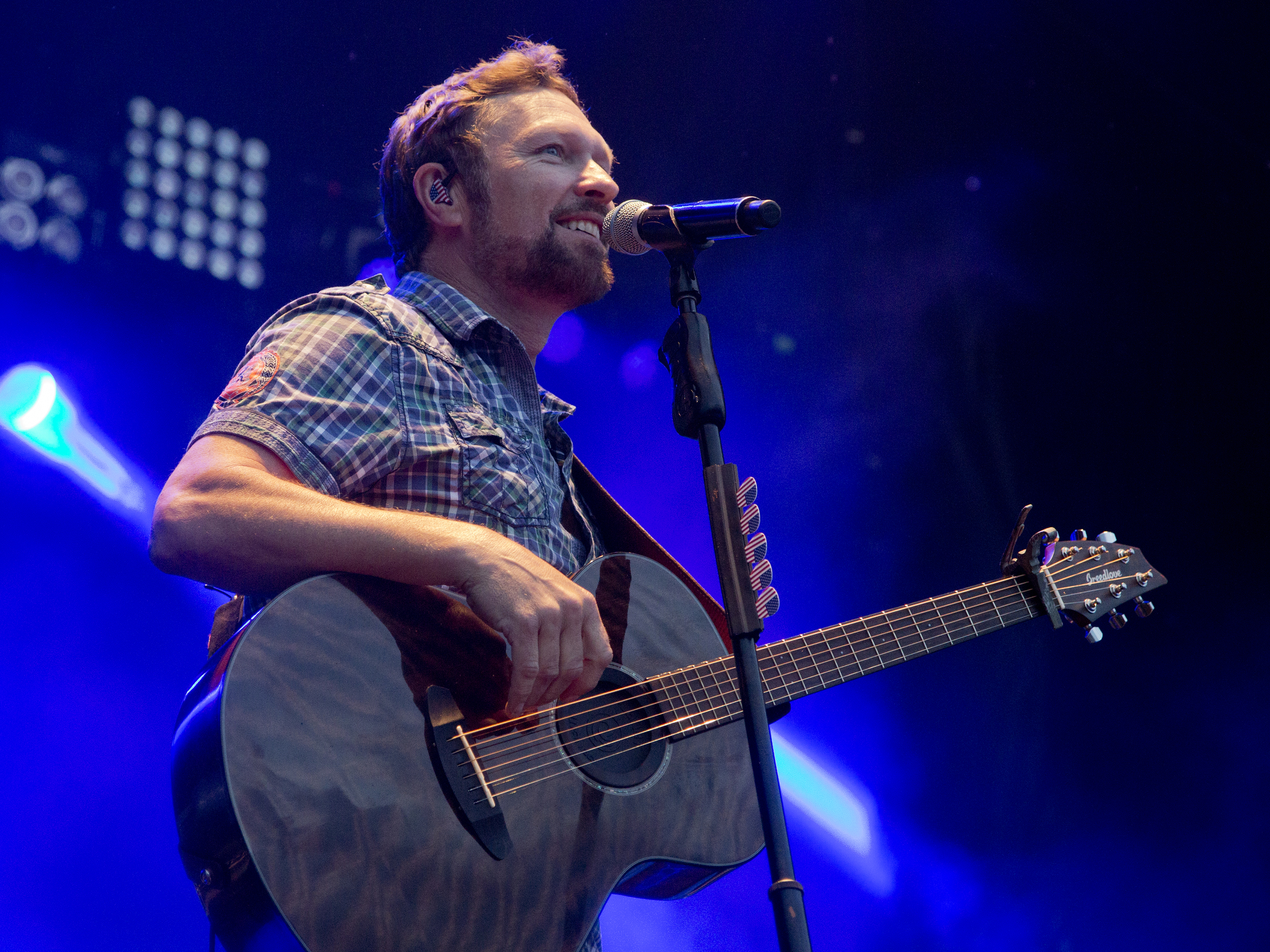 Picture of Craig Morgan playing guitar facing right. Picture from concert appearance.