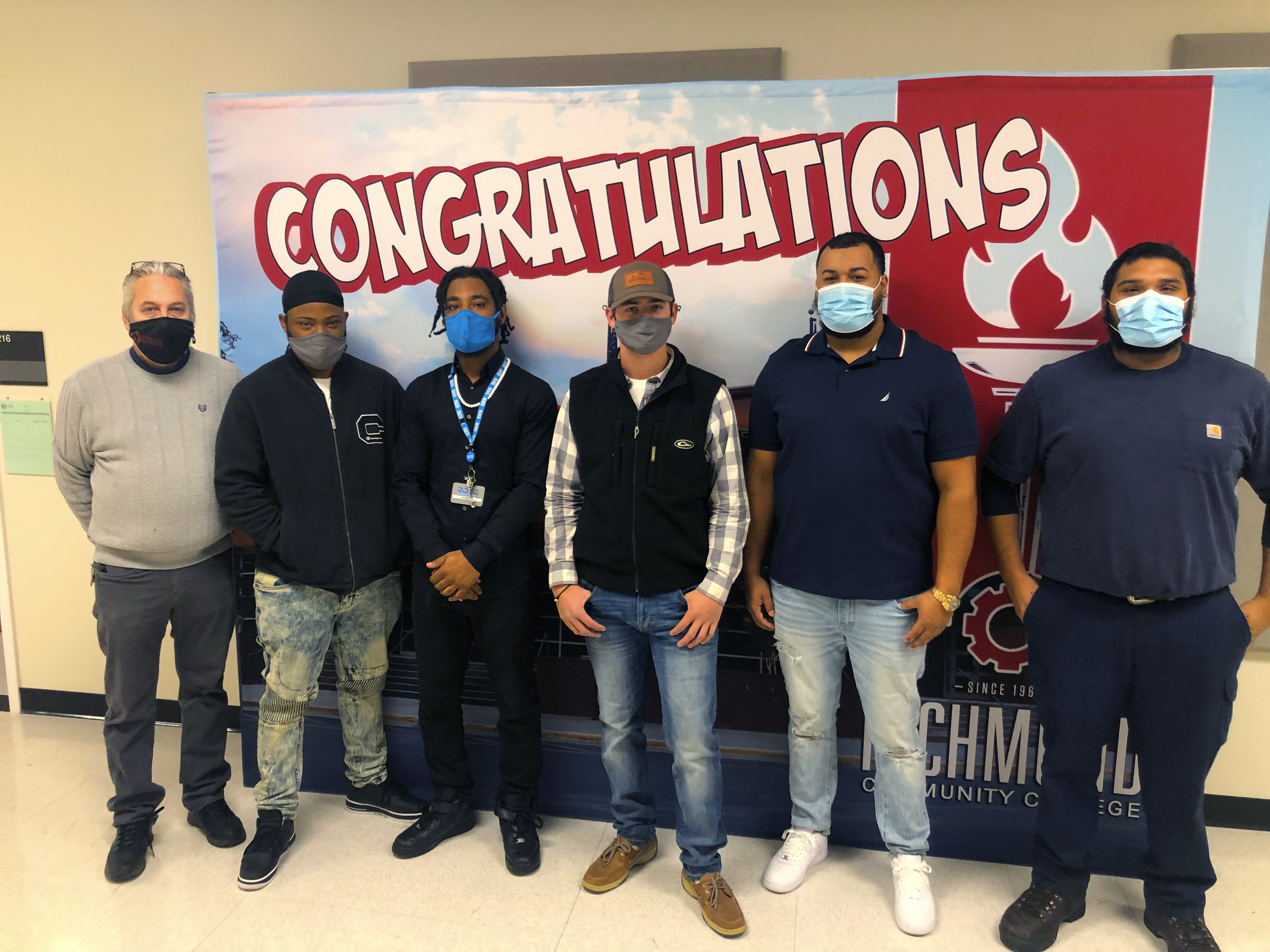 Industrial Mechanics graduates stand with their instructors