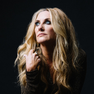 Photo of Lee Ann Womack with a black background
