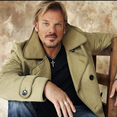 Photo of Phil Vassar in a green jacket and black t-shirt