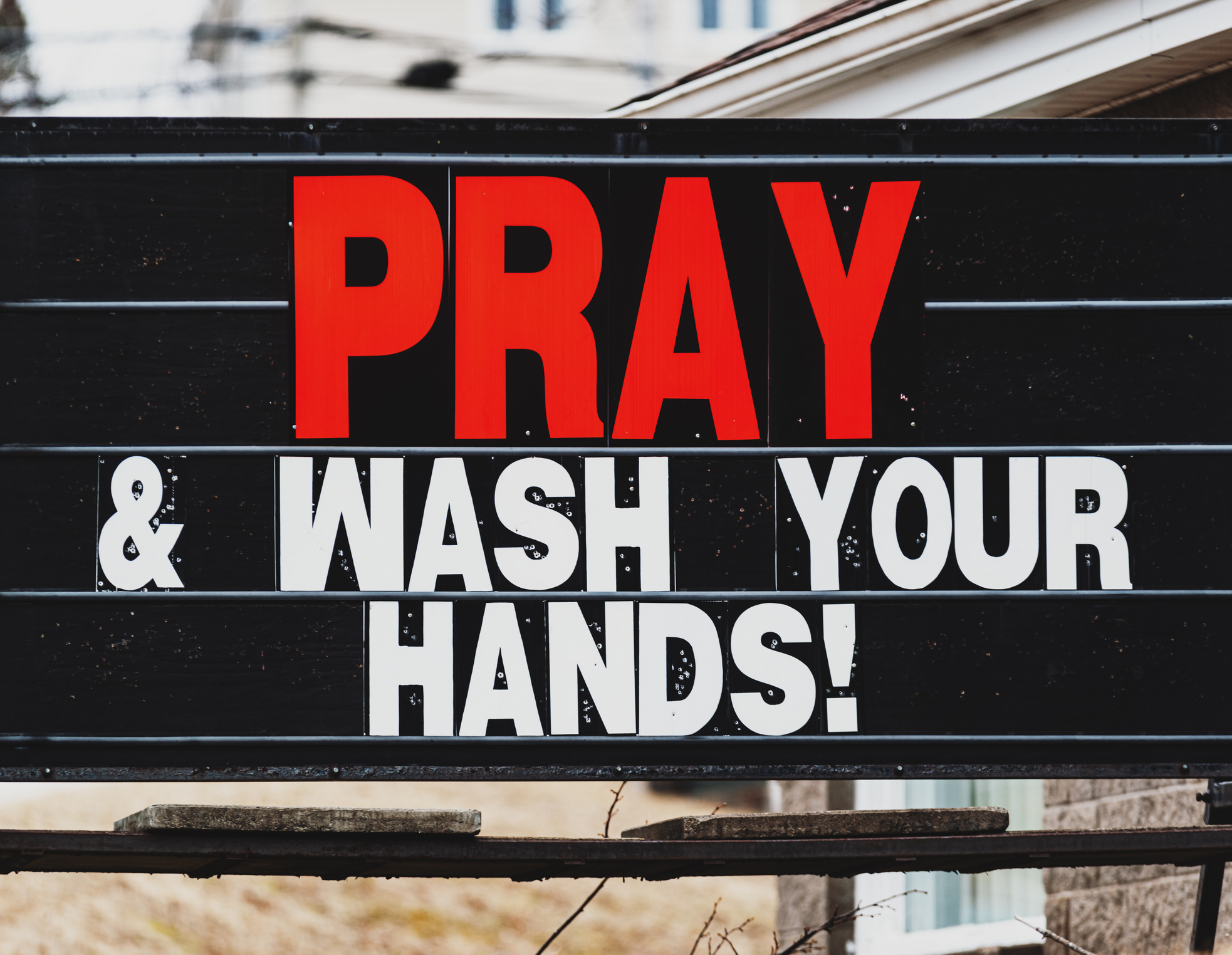 Sign for churches being open with message to wash hands