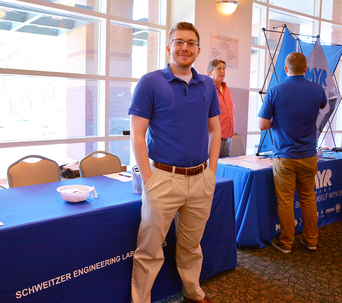 Substation graduate Sandy Guinn stands by the SEL table at the Power the World Career Fair.
