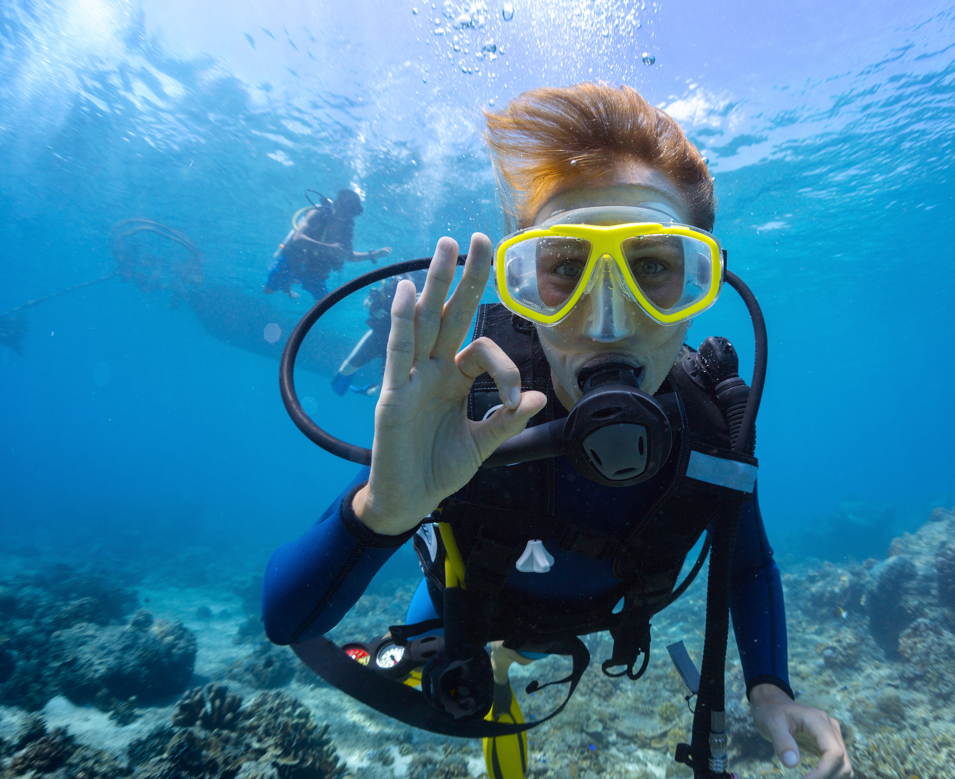 Scuba Diver underwater giving the OK sign
