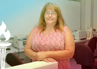 Health Information Technology graduate Ramona Laxton stands in a lab at Richmond Community College