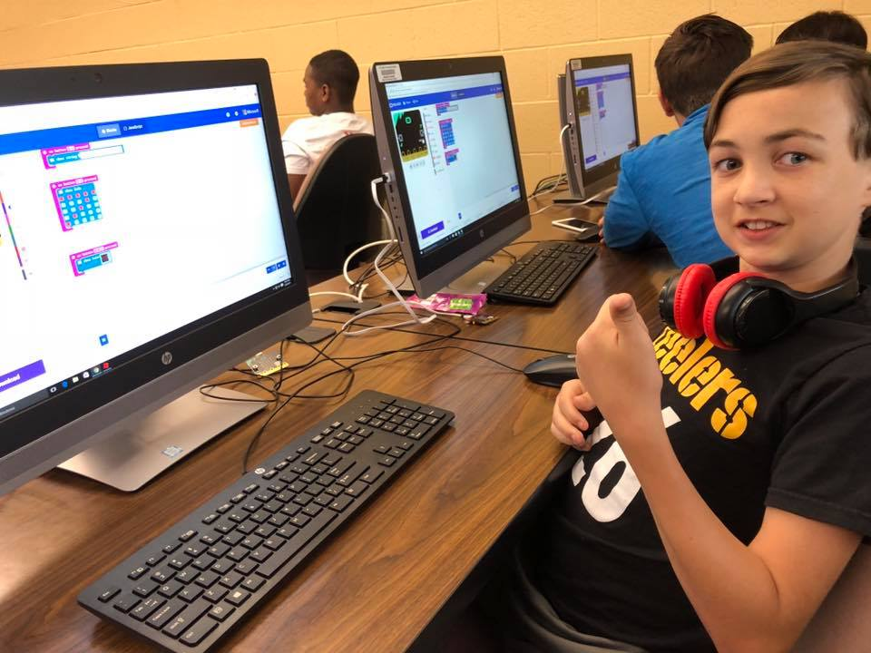 Student giving the thumbs up in a summer STEM camp
