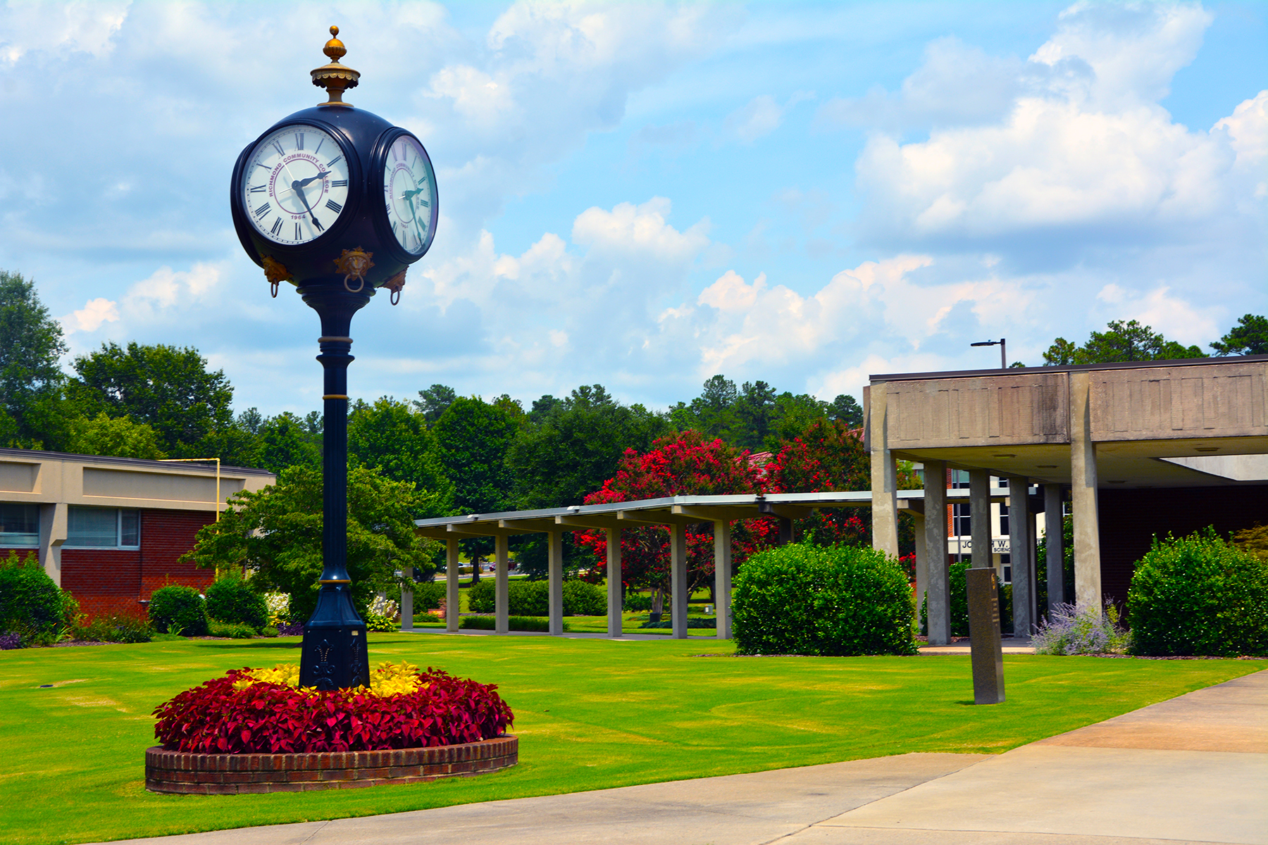 Photo of the campus with the clock on main campus