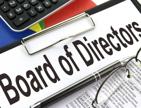 board of director clip board with glasses and keyboard