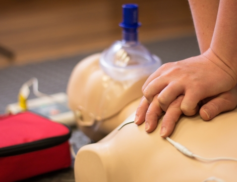 CPR compressions being done by a person for training