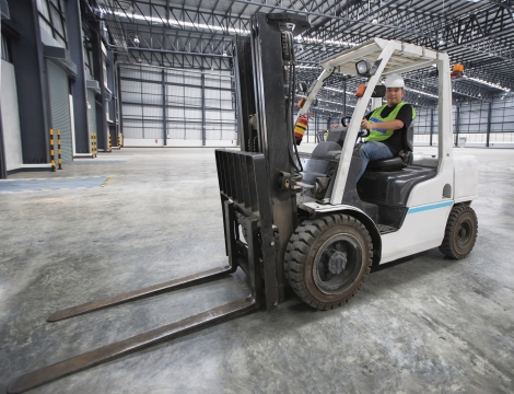 man sitting on a forklift