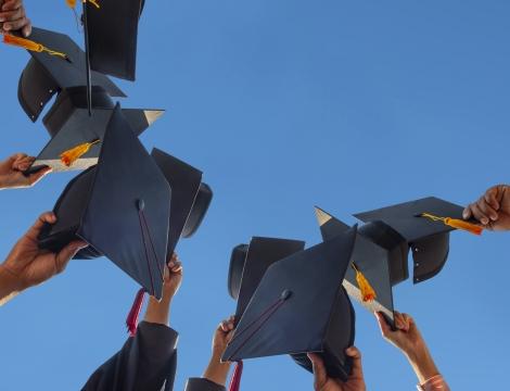 Grad caps being held up