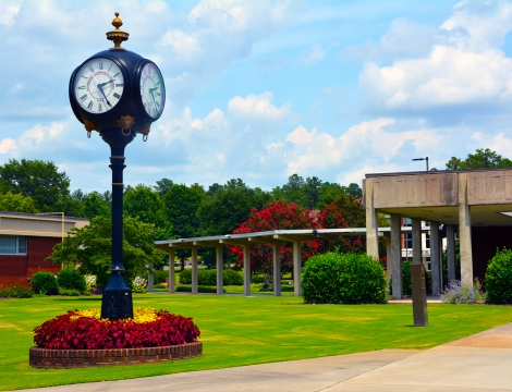 Picture of the campus with the clock in the foreground