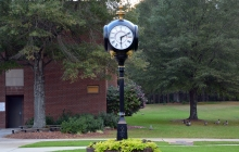 Photo of the clock in front of the DeWitt Building