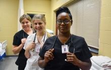 Nursing assistant student standing in nursing lab