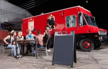 Food truck and people dining