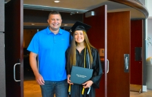 Graduate with her family member
