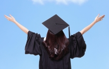 graduate with arms in the air