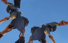Graduates holding up there hats