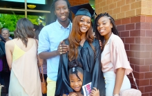 Graduate standing with family and friends