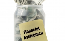 Money in Jar with sticky note about Financial Aid