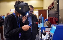 A young boy tries out the virtual welder at the Open House.