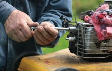 man working on a small engine