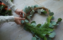 person making a wreath
