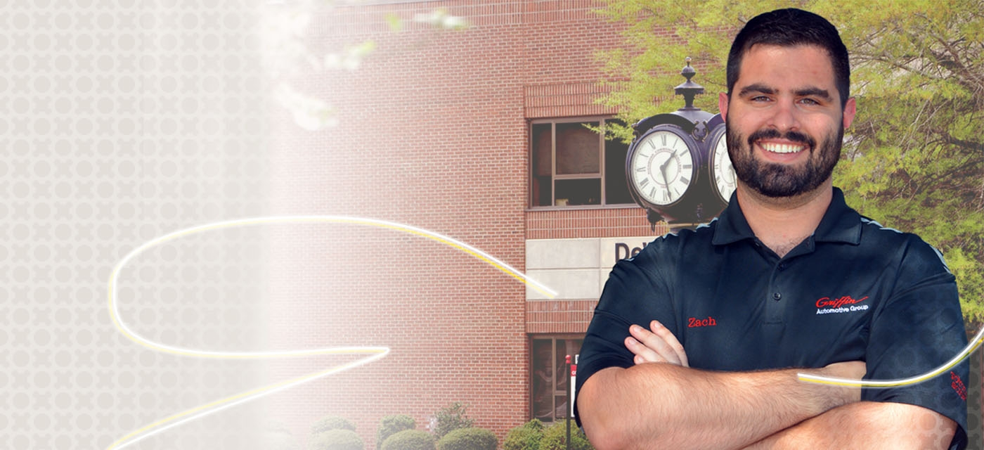 Photo of Working Scholarship student in front of clock of DeWitt Building