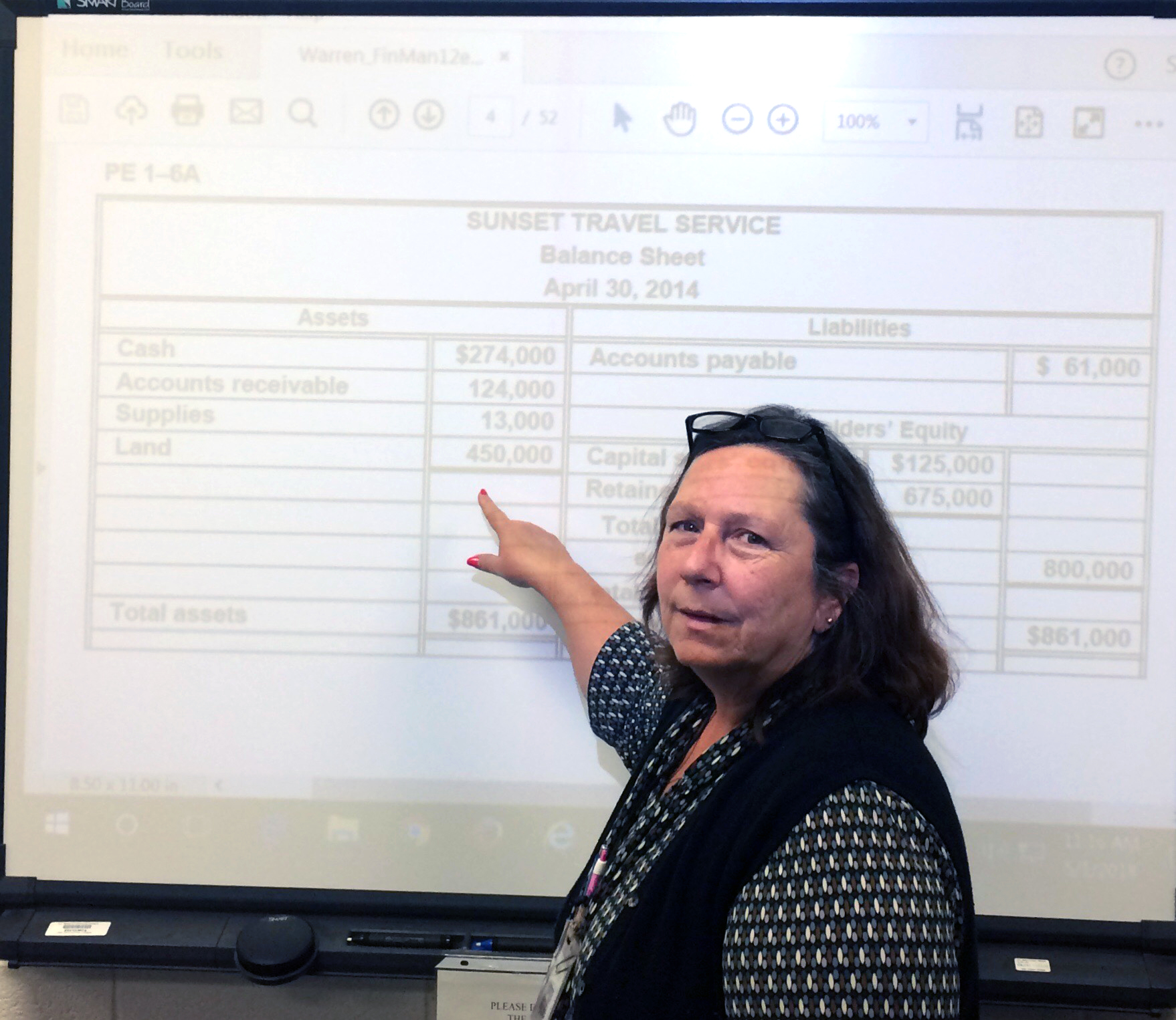 Wendy Pope stands at a white board in her classroom